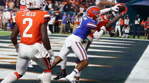 <p>               Virginia wide receiver Hasise Dubois (8) scores a touchdown against Florida defensive back Marco Wilson (3) during the first half of the Orange Bowl NCAA college football game, Monday, Dec. 30, 2019, in Miami Gardens, Fla. (AP Photo/Brynn Anderson)             </p>