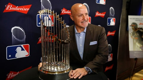 <p>               Washington Nationals general manager Mike Rizzo poses with the World Series trophy as he arrives for the premiere of a documentary film on the team's first World Series baseball championship, Monday, Dec. 2, 2019, in Washington. (AP Photo/Patrick Semansky)             </p>