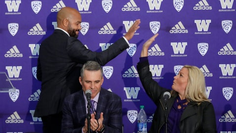 <p>               Washington NCAA college football head coach Chris Petersen, center, applauds as defensive coordinator Jimmy Lake, left, high-fives athletic director Jen Cohen after speaking during a news conference about Petersen's decision to resign and Lake taking over his job, Tuesday, Dec. 3, 2019, in Seattle. Petersen unexpectedly resigned on Monday, a shocking announcement with the Huskies coming off a 7-5 regular season and bound for a sixth straight bowl game under his leadership. Petersen will coach Washington in a bowl game, his final game in charge. (AP Photo/Elaine Thompson)             </p>