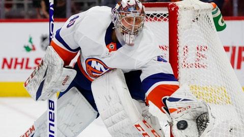 <p>               New York Islanders goaltender Semyon Varlamov (40) stops a Detroit Red Wings shot in the second period of an NHL hockey game Monday, Dec. 2, 2019, in Detroit. (AP Photo/Paul Sancya)             </p>