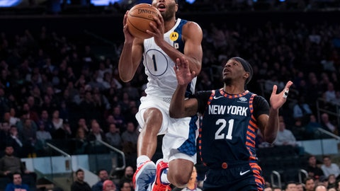 <p>               Indiana Pacers forward T.J. Warren (1) goes to the basket past New York Knicks guard Damyean Dotson (21) in the first half of an NBA basketball game, Saturday, Dec. 7, 2019, at Madison Square Garden in New York. (AP Photo/Mary Altaffer)             </p>