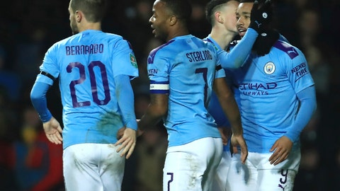 <p>               Manchester City's Raheem Sterling, second from left, celebrates with his teammates Bernardo Silva, Phil Foden and Gabriel Jesus, right, after scoring his side's third goal during the English League Cup quarter final soccer match between Oxford United and Manchester City at Kassam stadium, in Oxford, England, Wednesday, Dec. 18, 2019. (AP Photo/Leila Coker)             </p>