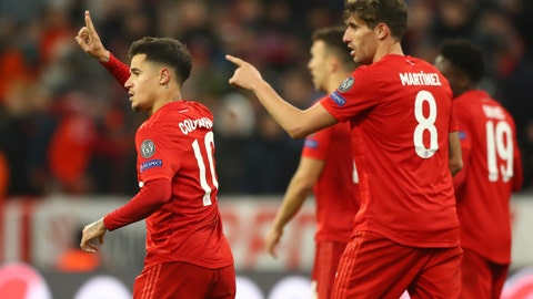 <p>               Bayern's Philippe Coutinho, left, celebrates with teammates after scoring his sides third goal during the Champions League group B soccer match between Bayern Munich and Tottenham Hotspur at the Allianz Arena stadium, in Munich, Wednesday, Dec. 11, 2019. (AP Photo/Matthias Schrader)             </p>