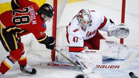 <p>               Carolina Hurricanes goalie James Reimer, right, blocks the net against Calgary Flames' Elias Lindholm during first-period NHL hockey game action in Calgary, Alberta, Saturday, Dec. 14, 2019. (Jeff McIntosh/The Canadian Press via AP)             </p>