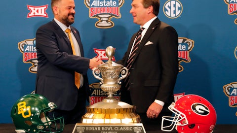 <p>               Georgia head coach Kirby Smart, right, and Baylor head coach Matt Rhule shake hands as they pose with the trophy during a Sugar Bowl NCAA college news conference in New Orleans, Tuesday, Dec. 31, 2019. The two teams meet on New Year's Day. (AP Photo/Gerald Herbert)             </p>