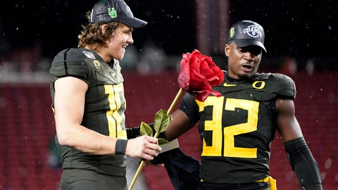 <p>               Oregon quarterback Justin Herbert (10) and teammate La'Mar Winston Jr. (32) celebrate after Oregon defeated Utah 37-15 in an NCAA college football game for the Pac-12 Conference championship in Santa Clara, Calif., Friday, Dec. 6, 2018. (AP Photo/Tony Avelar)             </p>