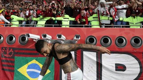 <p>               Flamengo's Gabriel Barbosa celebrates with Flamengo fans end of the Club World Cup semifinal soccer match between Flamengo and Al Hilal at the Khalifa International Stadium in Doha, Qatar, Tuesday, Dec. 17, 2019. (AP Photo/Hassan Ammar).             </p>