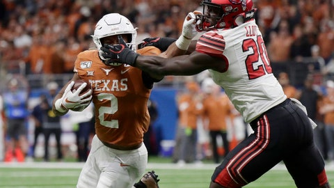 <p>               Texas running back Roschon Johnson (2) has his face mask grabbed by Utah linebacker Devin Lloyd (20) during the second half of the Alamo Bowl NCAA college football game in San Antonio, Tuesday, Dec. 31, 2019. (AP Photo/Eric Gay)             </p>