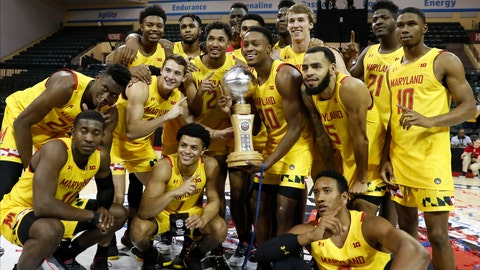 <p>               Maryland poses with the Orlando Invitational trophy after defeating Marquette during an NCAA college basketball game Sunday, Dec. 1, 2019, in Lake Buena Vista, Fla. (AP Photo/Scott Audette)             </p>