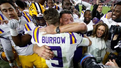 <p>               LSU head coach Ed Orgeron embraces quarterback Joe Burrow (9) after defeating Alabama 46-41 in an NCAA college football game, Saturday, Nov. 9, 2019, in Tuscaloosa, Ala. (AP Photo/John Bazemore)             </p>