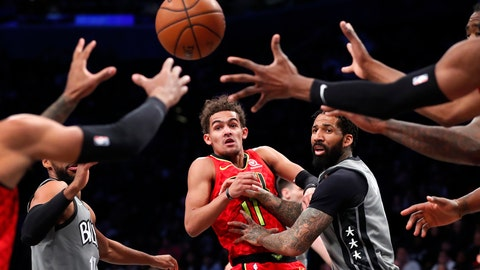 <p>               Atlanta Hawks guard Trae Young (11) passes the ball away from Brooklyn Nets forward Wilson Chandler during the first half of an NBA basketball game Saturday, Dec. 21, 2019, in New York. (AP Photo/Noah K. Murray)             </p>
