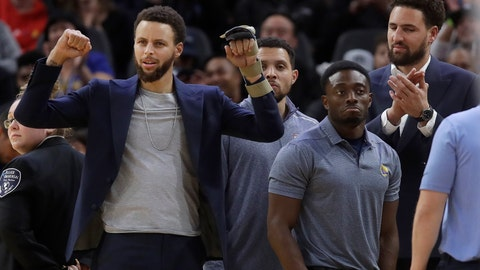 <p>               Injured Golden State Warriors guards Stephen Curry, left, and Klay Thompson, right, cheer a performer during a timeout in the second half of the team's NBA basketball game against the Chicago Bulls in San Francisco, Wednesday, Nov. 27, 2019. (AP Photo/Jeff Chiu)             </p>