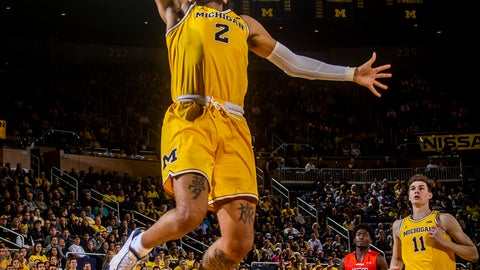<p>               Michigan forward Isaiah Livers (2) dunks during the second half of the team's NCAA college basketball game against Houston Baptist in Ann Arbor, Mich., Friday, Nov. 22, 2019. Michigan won 111-68. (AP Photo/Tony Ding)             </p>