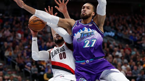 <p>               Portland Trail Blazers forward Carmelo Anthony (00) is fouled by Utah Jazz center Rudy Gobert (27) during the second quarter of an NBA basketball game, Thursday, Dec. 26, 2019, in Salt Lake City. (AP Photo/Jeff Swinger)             </p>