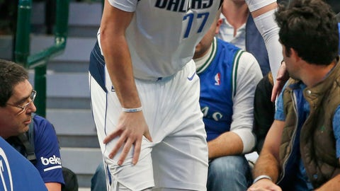 <p>               Dallas Mavericks forward Luka Doncic (77) reacts after injuring himself against the Miami Heat during the first half of an NBA basketball game in Dallas, Saturday, Dec 14, 2019. (AP Photo/Michael Ainsworth)             </p>