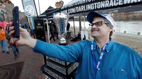 <p>               Louis Buckley takes a photo by the Darlington Raceway Southern 500 winner's trophy Wednesday, Dec. 4, 2019, during NASCAR Champion's Week in Nashville, Tenn. (AP Photo/Mark Humphrey)             </p>