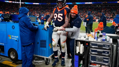 <p>               FILE - In this Dec. 1, 2019, file photo, Denver Broncos defensive end Derek Wolfe is helped off the field after getting hunt during the second half of the team's NFL football game against the Los Angeles Chargers in Denver. Wolfe's career year is finished and his eight-season stay in Denver might be over, too. The Broncos placed Wolfe on injured reserve Tuesday, 48 hours after he dislocated his left elbow in a 23-20 win over the Chargers. (AP Photo/Jack Dempsey, File)             </p>