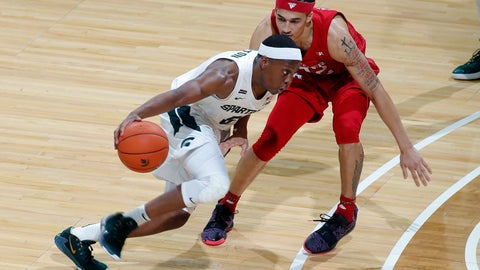 <p>               Michigan State's Cassius Winston, left, drives against Rutgers' Caleb McConnell during the first half of an NCAA college basketball game, Sunday, Dec. 8, 2019, in East Lansing, Mich. (AP Photo/Al Goldis)             </p>