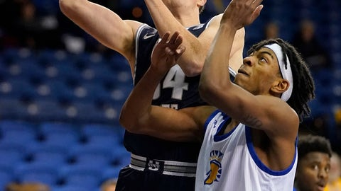 <p>               CORRECTS DAY OF WEEK - Utah State forward Justin Bean (34) drives to the basket against San Jose State guard Seneca Knight (13) during the first half of an NCAA college basketball game Wednesday, Dec. 4, 2019, in San Jose, Calif. (AP Photo/Tony Avelar)             </p>