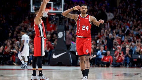 <p>               Portland Trail Blazers guard Kent Bazemore, right, and guard CJ McCollum react after Bazemore made a 3-point basket against the Orlando Magic during the second half of an NBA basketball game in Portland, Ore., Friday, Dec. 20, 2019. (AP Photo/Craig Mitchelldyer)             </p>
