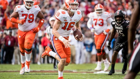 <p>               FILE - In this Nov. 30, 2019, file photo, Clemson quarterback Trevor Lawrence (16) carries the ball against South Carolina during the first half of an NCAA college football game, in Columbia, S.C. Heading into this year's slate of conference title games a case could be made that No. 1 LSU (No. 2 CFP), No. 2 Ohio State (No. 1 CFP) and No. 3 Clemson (No. 3 CFP) have all done enough already to lose their conference championship games and still get in the College Football Playoff.(AP Photo/Sean Rayford)             </p>