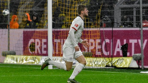 <p>               Leipzig's Timo Werner celebrates after scoring during the German Bundesliga soccer match between Borussia Dortmund and RB Leipzig in Dortmund, Germany, Tuesday, Dec. 17, 2019. Th match ended 3-3. (AP Photo/Martin Meissner)             </p>