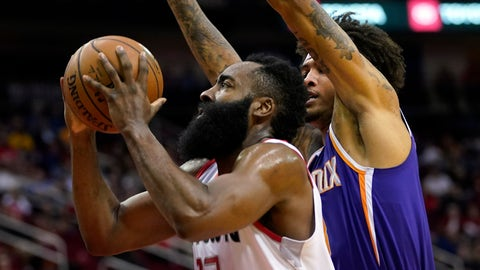 <p>               Houston Rockets' James Harden (13) goes up for a shot as Phoenix Suns' Kelly Oubre Jr. defends during the first half of an NBA basketball game Saturday, Dec. 7, 2019, in Houston. (AP Photo/David J. Phillip)             </p>