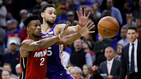 <p>               Philadelphia 76ers' Ben Simmons, right, and Miami Heat's Jimmy Butler reach for a pass during the second half of an NBA basketball game, Wednesday, Dec. 18, 2019, in Philadelphia. (AP Photo/Matt Slocum)             </p>