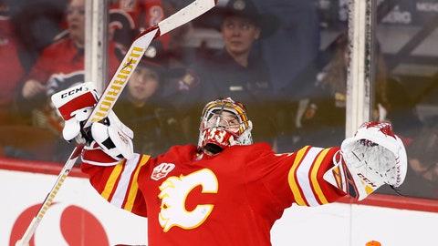 <p>               Calgary Flames goalie David Rittich, of the Czech Republic, celebrates the team's 3-1 victory over the Ottawa Senators in the third period of an NHL hockey game Saturday, Nov, 30, 2019, in Calgary, Alberta. (Larry MacDougal/The Canadian Press via AP)             </p>