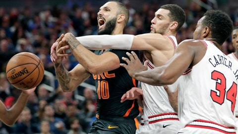 <p>               Orlando Magic guard Evan Fournier, left, is fouled as he goes up for a shot against Chicago Bulls guard Zach LaVine, center, and center Wendell Carter Jr. (34) during the second half of an NBA basketball game, Monday, Dec. 23, 2019, in Orlando, Fla. (AP Photo/John Raoux)             </p>