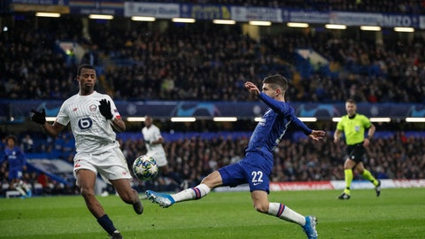 <p>               Chelsea's Christian Pulisic controls the ball next to Lille's Tiago Djalo during the Champions League Group H soccer match between Chelsea and Lille at Stamford Bridge stadium in London ,Tuesday, Dec.10, 2019. (AP Photo/Thanassis Stavrakis)             </p>