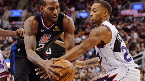 <p>               Los Angeles Clippers forward Kawhi Leonard, left, and Toronto Raptors guard Norman Powell (24) battle during the second half of an NBA basketball game, Wednesday, Dec. 11, 2019, in Toronto. (Nathan Denette/The Canadian Press via AP)             </p>