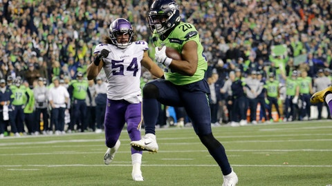 <p>               Seattle Seahawks' Rashaad Penny high steps into the end zone for a touchdown against the Minnesota Vikings during the second half of an NFL football game, Monday, Dec. 2, 2019, in Seattle. (AP Photo/John Froschauer)             </p>