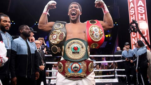<p>               Britain's Anthony Joshua celebrates after beating  Andy Ruiz Jr. on points to win their World Heavyweight Championship contest at the Diriyah Arena, Riyadh, Saudi Arabia early Sunday Dec. 8, 2019. (Nick Potts/PA via AP)             </p>