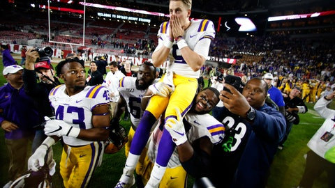 <p>               LSU quarterback Joe Burrow (9) is carried off the field by his teammates after defeating Alabama 46-41 in an NCAA college football game, Saturday, Nov. 9, 2019, in Tuscaloosa , Ala. (AP Photo/John Bazemore)             </p>