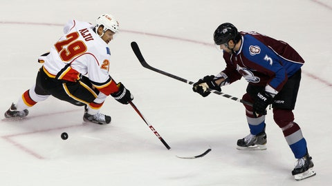 """<p>               FILE - In this Feb. 28, 2013, file photo, Calgary Flames right wing Akim Aliu loses control of the puck as the blade of his stick breaks off, while Colorado Avalanche's Ryan O'Byrne defends during the first period of an NHL hockey game in Denver. Former NHL forward Aliu expects """"big change"""" in hockey after a meeting with top league executives Tuesday. Aliu met with NHL Commissioner Gary Bettman and deputy commissioner Bill Daly in Toronto to discuss his allegation that former Flames coach Bill Peters used a racial slur several times during the 2009-10 season while the two were with the Chicago Blackhawks' top minor league affiliate in Rockford, Ill. The Flames investigated Aliu's claim, and Peters resigned last Friday. Peters apologized to the Flames and general manager Brad Treliving for using """"offensive language"""" in Rockford. (AP Photo/David Zalubowski, File)             </p>"""