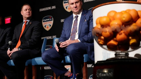 <p>               Virginia head coach Bronco Mendenhall, left, and Florida head coach Dan Mullen, right, listen during a news conference for the Orange Bowl NCAA college football game, Wednesday, Dec. 11, 2019, in Hollywood, Fla. Florida plays Virginia in the Orange Bowl Dec. 30 at Hard Rock Stadium in Miami Gardens, Fla. (AP Photo/Lynne Sladky)             </p>