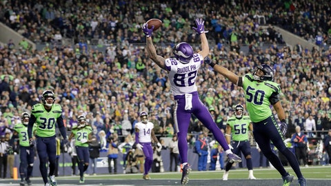 <p>               Minnesota Vikings' Kyle Rudolph reaches to catch a pass for a touchdown as Seattle Seahawks' K.J. Wright (50) reaches toward him during the second half of an NFL football game, Monday, Dec. 2, 2019, in Seattle. (AP Photo/Ted S. Warren)             </p>
