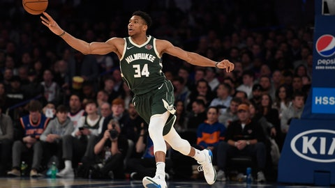 <p>               Milwaukee Bucks forward Giannis Antetokounmpo (34) passes the ball during the second half of the team's NBA basketball game against the New York Knicks in New York, Saturday, Dec. 21, 2019. (AP Photo/Sarah Stier)             </p>