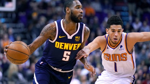 <p>               Denver Nuggets guard Will Barton (5) drives past Phoenix Suns guard Devin Booker in the first half of an NBA basketball game, Monday, Dec. 23, 2019, in Phoenix. (AP Photo/Rick Scuteri)             </p>