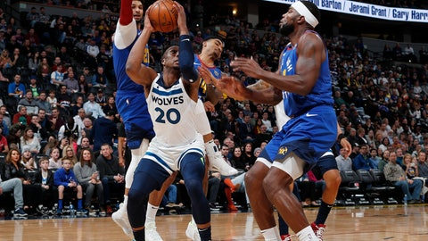 <p>               Minnesota Timberwolves guard Josh Okogie, front left, pulls in a rebound as Denver Nuggets forward Paul Millsap, front right, and guards Jamal Murray, back left, and Gary Harris defend in the first half of an NBA basketball game Friday, Dec. 20, 2019, in Denver. (AP Photo/David Zalubowski)             </p>