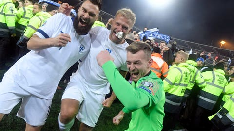 <p>               Finnish captain Tim Sparv, left, celebrates with Paulus Arajuuri, center, and goalkeeper Lukas Hradecky after their victory in the Euro 2020 Group J qualifying soccer match between Finland and Liechtenstein in Helsinki, Finland, on Friday, Nov. 15, 2019. Finland won 3-0 and have qualified for a major soccer tournament for the first time in their history. (Markku Ulander/Lehtikuva via AP)             </p>