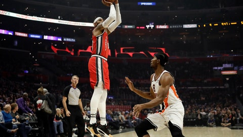 <p>               Portland Trail Blazers' Carmelo Anthony, left, shoots over Los Angeles Clippers' Maurice Harkless during the first half of an NBA basketball game Tuesday, Dec. 3, 2019, in Los Angeles. (AP Photo/Marcio Jose Sanchez)             </p>