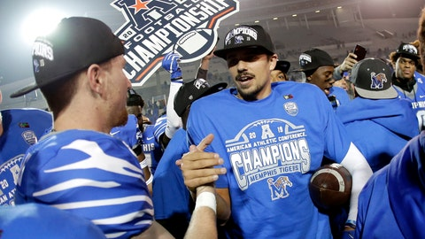 <p>               Memphis quarterback Brady White, center, celebrates after his team defeated Cincinnati in an NCAA college football game for the American Athletic Conference championship Saturday, Dec. 7, 2019, in Memphis, Tenn. (AP Photo/Mark Humphrey)             </p>