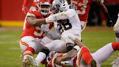 <p>               Kansas City Chiefs linebacker Damien Wilson (54) and defensive tackle Derrick Nnadi, bottom, tackle Oakland Raiders running back Josh Jacobs (28) during the first half of an NFL football game in Kansas City, Mo., Sunday, Dec. 1, 2019. (AP Photo/Charlie Riedel)             </p>