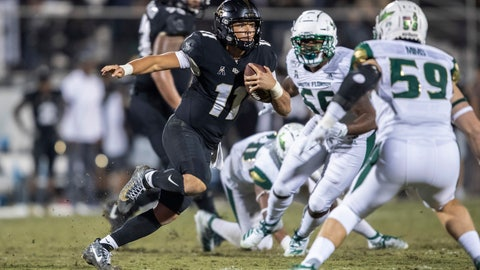 <p>               Central Florida quarterback Dillon Gabriel (11) sprints away from the South Florida defense during the second half of an NCAA college football game Friday, Nov. 29, 2019, in Orlando, Fla. (AP Photo/Willie J. Allen Jr.)             </p>