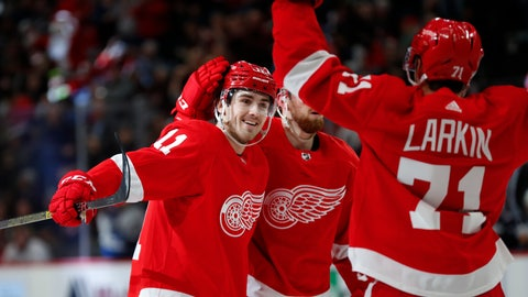 <p>               Detroit Red Wings right wing Filip Zadina (11) celebrates his goal with Filip Hronek (17) and Dylan Larkin (71) in the second period of an NHL hockey game against the Winnipeg Jets, Thursday, Dec. 12, 2019, in Detroit. (AP Photo/Paul Sancya)             </p>
