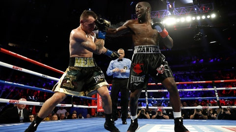 <p>               Terence Crawford, right, punches Lithuania's Egidijus Kavaliauskas, knocking him down for a TKO in the ninth round of a WBO welterweight boxing match, Saturday, Dec. 14, 2019, in New York. (AP Photo/Michael Owens)             </p>