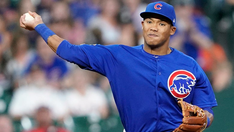 Cubs cut Russell year after domestic violence ban