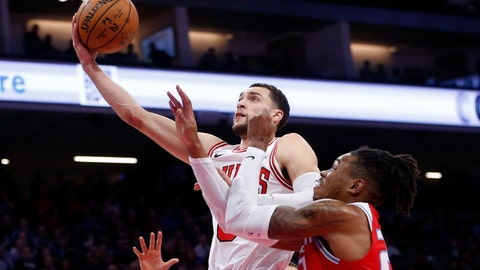<p>               Chicago Bulls guard Zach LaVine, left, goes to the basket against Sacramento Kings forward Richaun Holmes, right, during the first quarter of an NBA basketball game Monday, Dec. 2, 2019, in Sacramento, Calif. (AP Photo/Rich Pedroncelli)             </p>